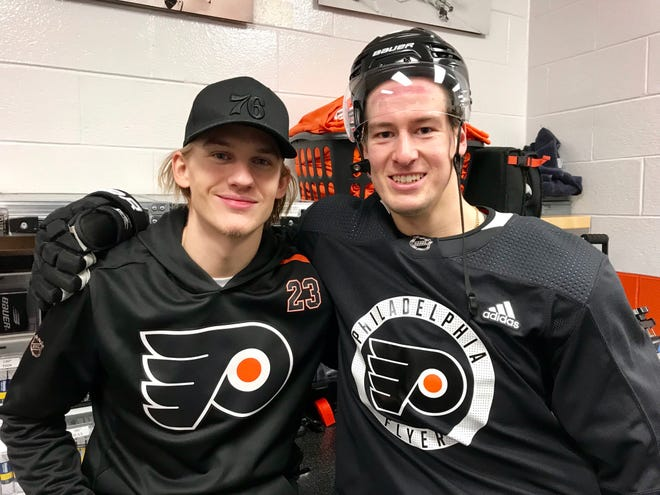 Oskar Lindblom, left, took a photo with fellow Swede and good friend Robert Hägg before the Flyers' morning skate Tuesday.