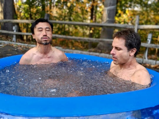 Cherry Hill native Jonathan Greenfield (right) soaks in an ice bath, part of a meditation practice developed by Wim Hof. Greenfield began using the method shortly after he was diagnosed with amyotrophic lateral sclerosis, or ALS.