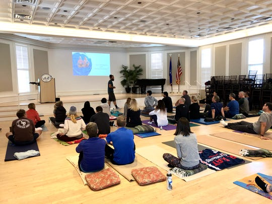 Michael Christoforo, a certified Wim Hof instructor, leads participants at a Breathe 4 ALS  community event in Westport, Conn., on Nov. 3, 2019.