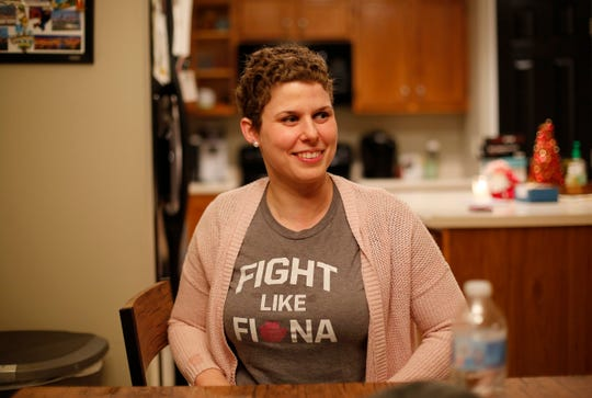 Beth Brubaker recalls her fight with breast cancer at her Campbell County home on Monday. She was diagnosed with it just a few days before she learned she was pregnant. A colleague of her husband, Jason Brubaker, gave her this 'Fight like Fiona' T-shirt, which Beth says inspired her during her treatment and pregnancy.