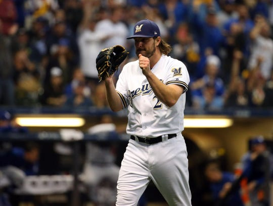 Oct 19, 2018; Milwaukee, WI, USA; Milwaukee Brewers starting pitcher Wade Miley (20) reacts after the third inning against the Los Angeles Dodgers in game six of the 2018 NLCS playoff baseball series at Miller Park.