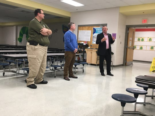Montgomery County Mayor Jim Durrett discusses the proposed, new animal shelter at a town hall meeting Monday, as Animal Control Director Dave Kaske, left, and project architect Jon Clark, listen.
