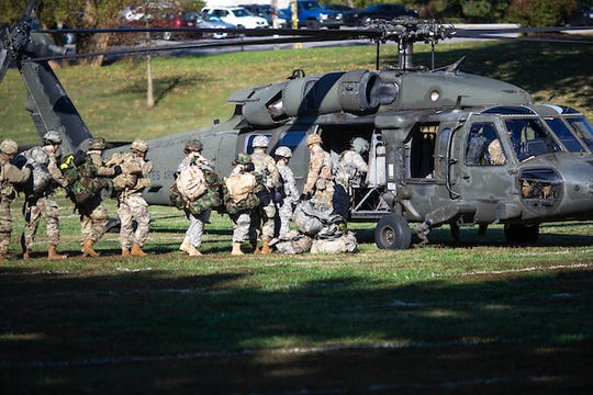 ROTC cadets conducting training with Black Hawk helicopters.