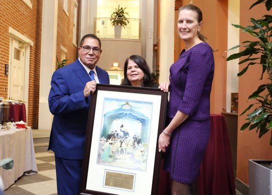 (Left to right): Gil Medina, TESU Board of Trustees; Wanda Saez, Senior Vice President, Corporate Responsibility and Community Relations, Wells Fargo;, Dr. Merodie Hancock, president, Thomas Edison State University with a plaque commemorating the gift.