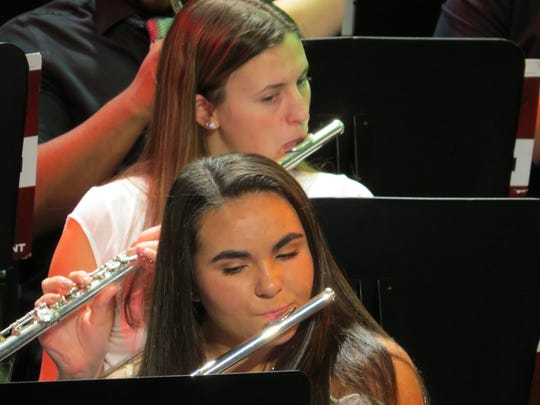 Sydney Sweeney of Cranford (above) and Kapriana Payami of Scotch Plains perform in the Upper School Winter Concert.