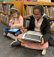 "Franklin first grader Rhyan Sporer (left) and 5th grader Hailey Latcha enjoy coding during ""Hour of Code"" activities as part of Computer Science Education Week."