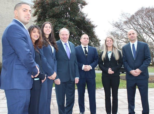 New Jersey State Parole Board Chairman Samuel J. Plumeri, Jr. (center- fourth from the left) joins six new parole officer recruits at their graduation ceremony held at Monmouth University.