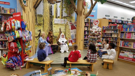 Members of the W+H Middle School production of Frozen Jr. read stories to children at Barnes & Noble. Readers, from left: Sarah Alves of Springfield, Julia Machado of Edison and Tommy Majkowski of Woodbridge.