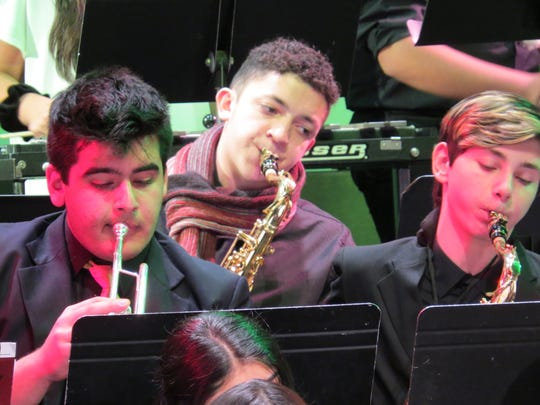 Shiv Tickoo of Scotch Plains, Nicolas Hernandez-Webster of Edison and David Ezra Flatau-Jones of Scotch Plains play a tune for the Concert Band.
