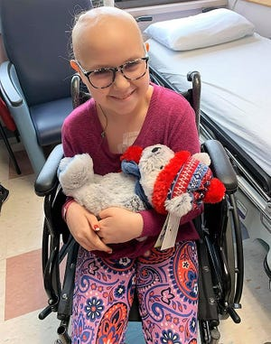 Ava Winner with a teddy bear named Jordan she received at Akron Children's Hospital recently while receiving chemotherapy treatment. Ava was diagnosed with a brain tumor last January and has been receiving treatment for it this past year.