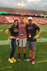 Iowa State 2020 quarterback recruit Aidan Bouman poses with his parents during a visit to Ames.