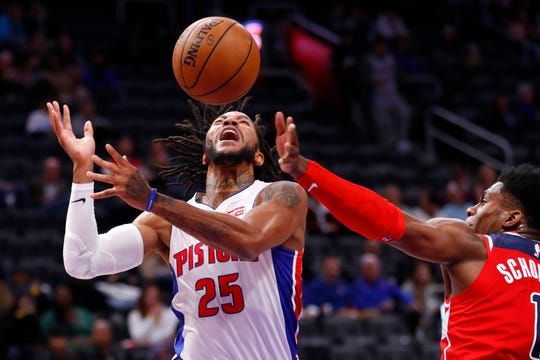 Detroit Pistons guard Derrick Rose (25) is fouled by Washington Wizards guard Admiral Schofield (1) in the first half of an NBA basketball game in Detroit, Monday, Dec. 16, 2019. (AP Photo/Paul Sancya)