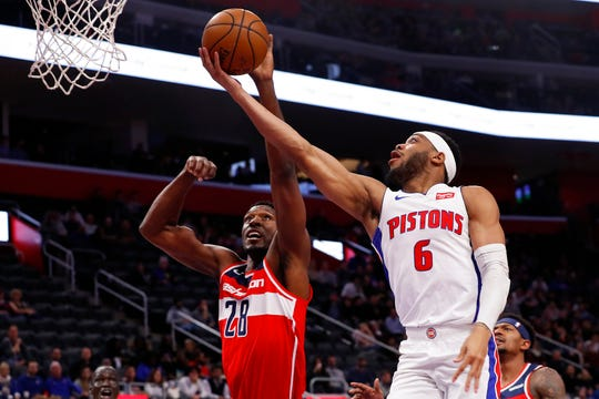 Detroit Pistons guard Bruce Brown drives on Washington Wizards center Ian Mahinmi in the first half in Detroit, Monday, Dec. 16, 2019.