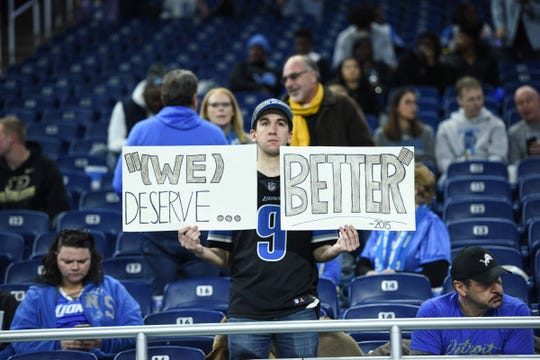 Detroit Lions fan holds up a sign before the game against the Tampa Bay Buccaneers at Ford Field, Dec. 15, 2019.