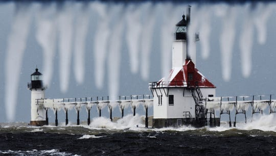 In this Nov. 12, 2019, file photo, snow and ice accumulates on the St. Joseph Lighthouses, as a fall snow storm moves through St. Joseph, Mich.