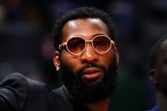 Detroit Pistons center Andre Drummond watches from the bench in the first half against the Washington Wizards in Detroit, Monday, Dec. 16, 2019.