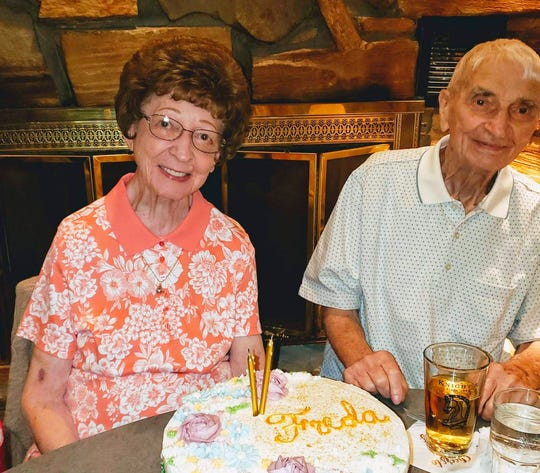 This June 2019 photo provided by Leah Smith shows Les and Freda Austin of Jackson, of Michigan, pose for a photo at a birthday party. The Michigan couple, who family members say did everything together for 70 years up to their final breaths, died 20 minutes apart in the same hospice care on Dec. 6, MLive.com reports.