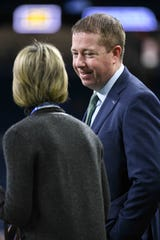 Detroit Lions general manager Bob Quinn talks to vice chair Sheila Ford Hamp before the game against the Tampa Bay Buccaneers at Ford Field, Dec. 15, 2019.