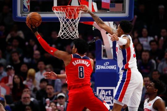 Washington Wizards forward Rui Hachimura (8) drives on Detroit Pistons forward Christian Wood (35) in the first half of an NBA basketball game in Detroit, Monday, Dec. 16, 2019. (AP Photo/Paul Sancya)