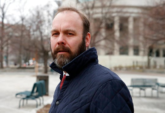 In this Feb. 14, 2018, file photo, Rick Gates departs federal court in Washington.