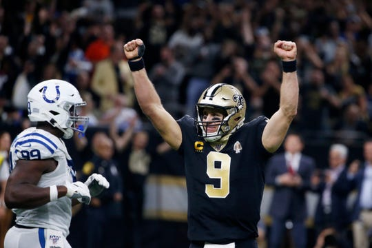 New Orleans Saints quarterback Drew Brees (9) celebrates his touchdown pass to tight end Josh Hill, which broke the NFL record for career touchdown passes, surpassing Peyton Manning, in the second half against the Indianapolis Colts Monday.