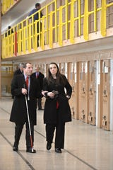 "Heidi Washington escorts Michigan Supreme Court Justice Richard Bernstein in March 2015 as he visits the Charles Egler Correctional Facility at the Jackson prison complex. Washington, now director of the Michigan Department of Corrections, said at a Monday town hall that prison time should be ""productive time."""