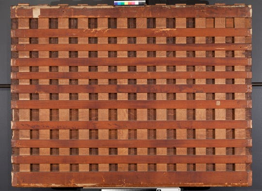 """The grid-work """"cradle"""" on the back of Bruegel's """"Wedding Dance,"""" likely added in the 19th century, that keeps the oak panel from warping."""