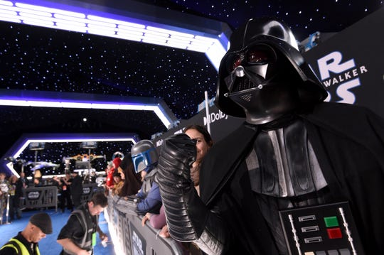 "Roberto Gomez, of Puerto Rico, dressed as Darth Vader, attends the world premiere of ""Star Wars: The Rise of Skywalker"" on Dec. 16, 2019, in Los Angeles."