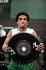 Safety Makari Paige works out in the weight room at West Bloomfield High.
