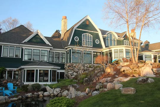 On Lake Charlevoix, this8,669 square foot home offers an up north lakefront experience.