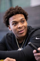 Linebacker Cornell Wheeler gives an interview this week at West Bloomfield High School.