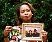 "In this Sept. 6, 2019, photo, Donna Cryer holds up family photos that include her father Roland Henry, as she poses for a photo in Washington. When her father died, she tried to donate his organs, yet the local organ collection agency said no, without talking to the family or providing a reason. ""It was devastating to be told there was nothing they considered worthy of donation. Nada. Not a kidney, not a liver, not tissue,"" recalled Donna Cryer, president of the nonprofit Global Liver Institute and herself a recipient of a liver transplant."