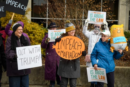 Attending a midday rally, left to right, B.J. Gilles, Maureen Mattingly and Jan Reed show their support for the impeachment of President Trump in front of the Federal Building in Evansville Tuesday, December 17, 2019.