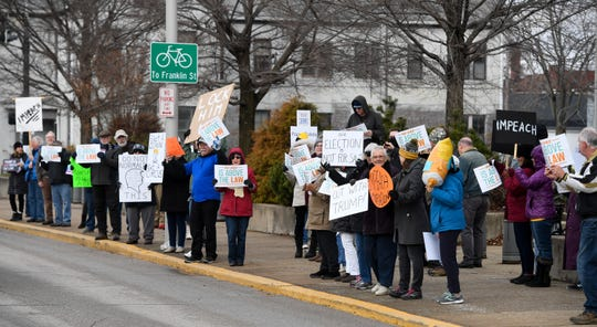 A rally for the impeachment of President Trump in front of the Federal Building in Evansville Tuesday, December 17, 2019.