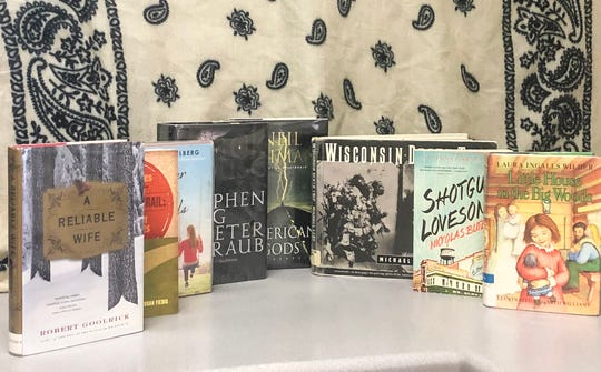 "Pictured are, from left, eight fiction and non-fiction books set in Wisconsin: ""A Reliable Wife"" by Robert Goolrick; ""Adventures on the Bloody Trail: The Quest Continues"" by Susan Fiebig; ""Better off Friends"" by Elizabeth Eulberg; ""Little House in the Big Woods"" by Laura Ingalls Wilder; ""Shotgun Lovesongs"" by Nikolas Butler; ""Black House"" by Stephen King and Peter Straub; ""American Gods"" by Neil Gaiman; and ""Wisconsin Death Trip"" by Michael Lesy.  In addition to purchasing books online and in-store, readers can be found at the local library. Many of the books pictured were found at the Fond du Lac Public Library."