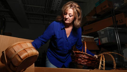 Peg Pichler sorts through boxes of baskets and other items on Dec. 16 at the Boys and Girls Club of Green Bay in Green Bay.