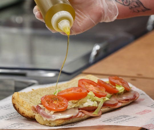 Oil is added to a sandwich at Casey'ss General Store in Oshkosh.