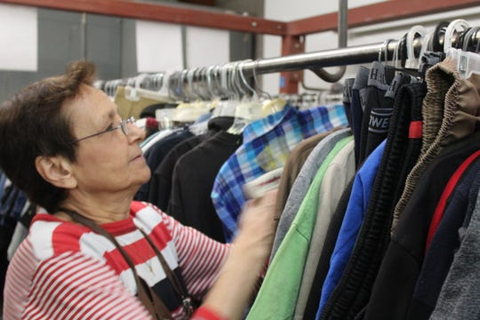 The pace is fast at the Salvation Army's pricing racks. On any given day veteran store employee, Gloria Lopez, will tag and stock 600 to 700 clothing items.