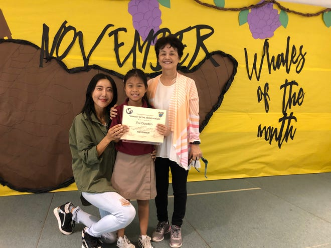 Second-grader Yui Gosden was awarded the November Whale of the Month on Dec. 2 from Michelle Luzano's class at Tamuning Elementary School. Gosden is pictured with her mom, Jenny, and grandmother, Eiko.