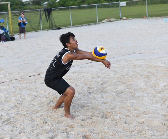 Zachary Taisacan bumps the ball during a beach volleyball game at the Guam Football Association National Training Center sand courts in Dededo in this Dec. 17, 2019, file photo. Beach volleyball kicks things off for IIAAG sports March 1 with two games. PDN FILE PHOTO