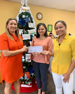 """Guam Premier Outlets is proud to support Mane'lu's annual event """"Breakfast with Santa"""" held Dec. 7 at Outrigger. Pictured from left: Samantha Taitano, Mane'lu executive director; Suzanne Perez, GPO director of marketing and operations; Cheryl Chargualaf, Mane'lu program assistant."""