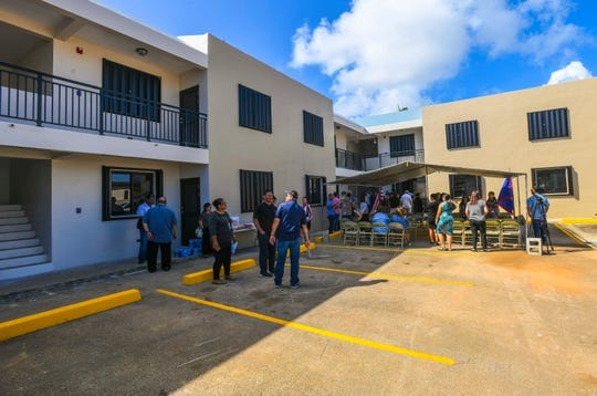 A ribbon cutting is held for the completion of renovation work performed on a14-unit apartment complex in Mangilao in this Dec. 17, 2019, file photo. The units were slated to be made available to low- to moderate-income families.