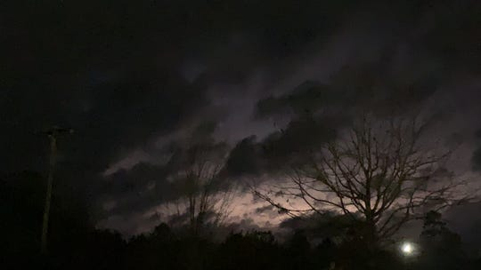 Lightning lights up the evening sky in west Hattiesburg after a tornado passed through the area on Monday, Dec. 16, 2019.