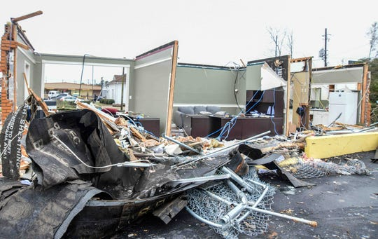 Remains of a business on 15th Avenue in Laurel, Miss. sit after a tornado ripped through town Monday, Dec. 16, 2019.