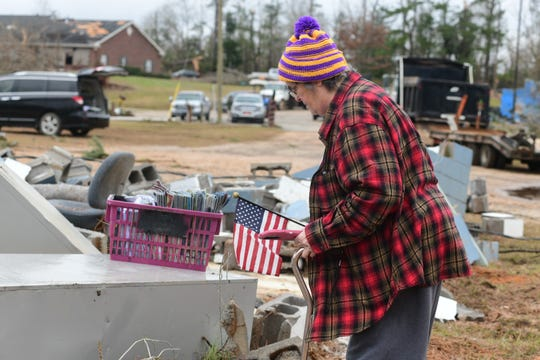 Sumrall resident Cynthia Baughman picks through the rubble at the American Legion Post 61 after a tornado destroyed the building on Dec. 16, 2019.