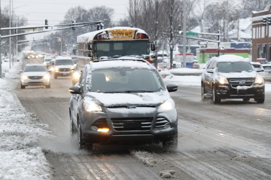 Morning commuters make their way along West 38th Street in Indianapolis on Tuesday, Dec. 17, 2019.