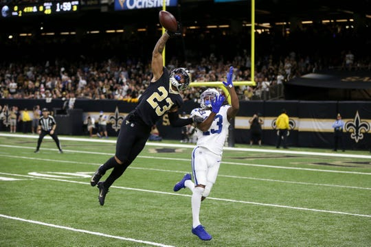 Dec 16, 2019; New Orleans, LA, USA; New Orleans Saints cornerback Marshon Lattimore (23) defends a pass intended for Indianapolis Colts wide receiver T.Y. Hilton (13) in the fourth quarter at the Mercedes-Benz Superdome.
