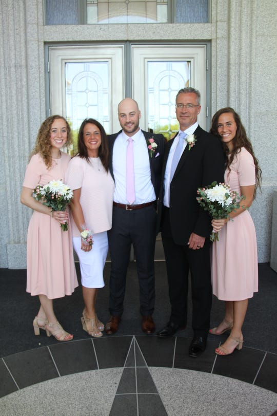 IMPD Chief Bryan Roach poses with his family at his son's wedding in June 2019. From left: daughter Madalyn; wife Marie; son Bryan; and daughter Macey.