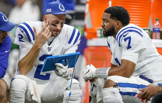 Indianapolis Colts quarterbacks Brian Hoyer (2) and Jacoby Brissett (7) talk on the bench during the third quarter against the New Orleans Saints at Mercedes-Benz Superdome in New Orleans on Monday, Dec. 16, 2019.
