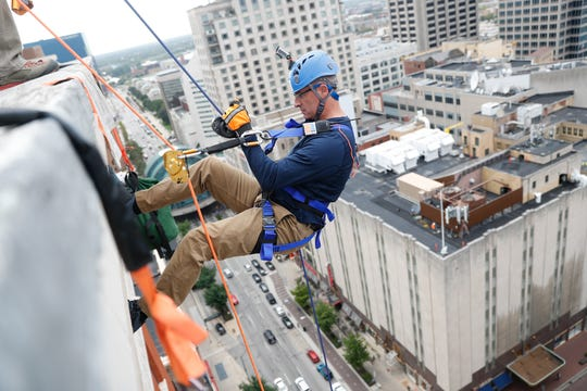 """IMPD Chief Bryan Roach goes, """"Over the Edge,"""" rappelling 17-stories down the Barnes & Thornburg building in efforts to raise funds to stop youth violence in Indianapolis on Thursday, Sept. 27, 2018. The two-day event benefited the Central Indiana Youth for ChristÕs Juvenile Justice Ministry."""